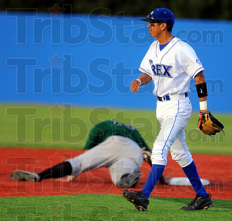 Another one's gone: Rex shortstop Ray Hernandez strides back to his position as Dans baserunner Tyler Brubaker lays at second base. Hernandez tagged him out trying to steal.