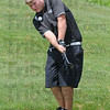 Eye on the ball: Northview's Josh Hoskins hits a shot during sectiona action at Rolling Meadows golf course Monday morning.