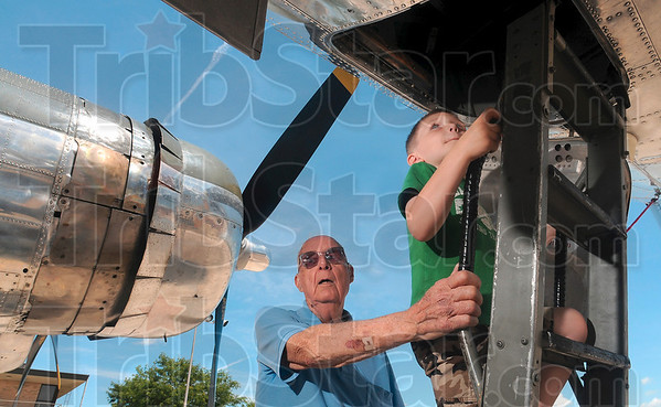 Tribune-Star/Joseph C. Garza<br /> He flew in one: West Terre Haute native Bernie Monaghan talks with a crew member of the B-17 bomber, Sentimental Journey, as he and his great-grandson, Hunter Monaghan, 5, climb aboard the aircraft Monday at the Terre Haute International Airport/Hulman Field. Monaghan flew in a B-17 during World War II as a tail gunner.