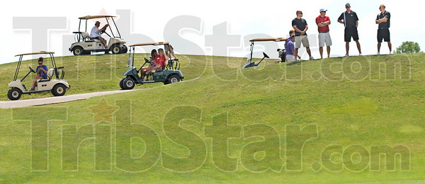 Vantage point: Golf coaches and spectators gather at the ninth hole watching match action between Terre Haute South, Owen Valley and Northview during Monday's sectional play.