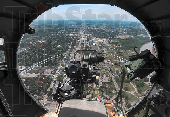 Tribune-Star/Joseph C. Garza<br /> Nose view: The B-17 bomber, Sentimental Journey, flies over Third Street near the intersection of Farrington and Third Streets Monday after taking off from Terre Haute International Airport/Hulman Field.