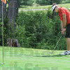 Drop: South's Thomas Goss watches his ball fall into the cup as he putts from the fringe during match action Monday morning during sectional play.