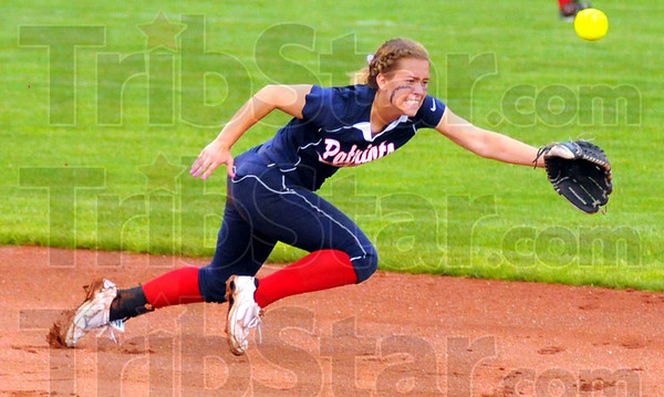 All in: Danille Ketner dives for the ball in the Patriots' oft delayed State Championship game in Indianapolis last week.