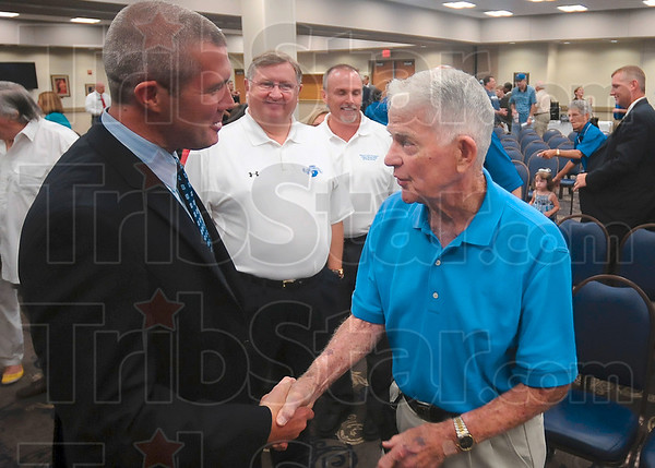 Tribune-Star/Joseph C. Garza<br /> Longtime supporter: New Indiana State head coach Greg Lansing is congratulated by fan and Class of 1951 graduate Jim Hartman after Lansing was announced as the new head coach Tuesday at Hulman Center.