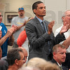 Tribune-Star/Joseph C. Garza<br /> Player support, past and present: Former Indiana State basketball player Nate Green stands to applaud with other members of the audience Tuesday during a press conference for new head basketball coach, Greg Lansing, at Hulman Center.