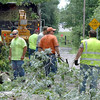 Chips: Terre Haute Street Department employees remove debris from Monday's storms near the intersection of 16th and Carl Avenue Tuesday afternoon.