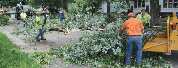 Storm related: Terre Haute Street Department crews work to remove fallen debris on Lafayette Avenue near 16th Street Tuesday afternoon.