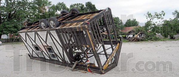 Ubber troubles: A trailer used by the German Oberlander Club rests on its roof at the north Lafayette Avenue location. At right a large Walnut tree has fallen through the roof of the shelter on the property.