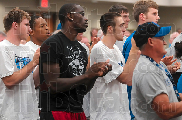 Tribune-Star/Joseph C. Garza<br /> Stand and applaud for the new coach: Indiana State men's basketball team members Aaron Carter, Dwayne Lathan, Carl Richard, Jake Odum and RJ Mahurin applaud after Greg Lansing was announced as the new head coach of the Sycamores Tuesday at Hulman Center.