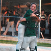 North Central pitcher Ashli Scott jumps into the arms of catcher Alainey Thompson after the Thunderbirds defeated Loogootee in the regional softball championship Tuesday at North Central.