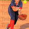 Got it: Patriot second baseman Hailee Travioli grabs a pop fly for an out against East Central.