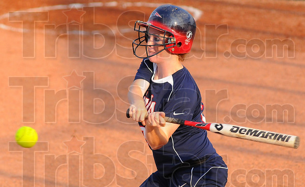 Timely: Patriot batter Alisha ludwig raps a hit against East Central.