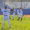 Warmups: Members of the Rex baseball team warm up prior to an open practice Tuesday evening.