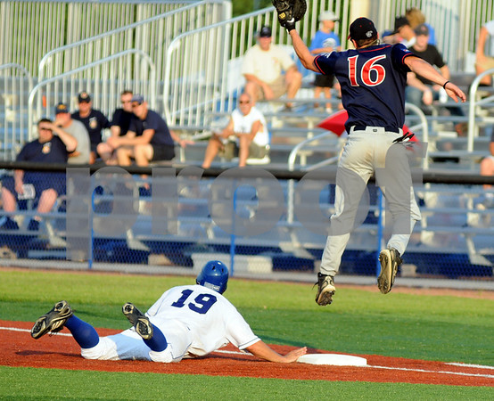 Back: Rex #19, Alex Guthrie makes it back to the bag as Chillicothe's #16, Ian Nielsen jumps to catch a high throw.