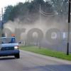 Buzz off: Joe Beal of the Vigo County Health Department sprays for mosquitoes along Haythorne Avenue Monday evening.