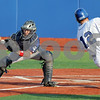 Score: Rex #12, Jared Broughton is about to score around the tag of Chillicothe catcher Brandon White during game action Tuesday night at Bob Warn Field.