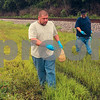 Tribune-Star/Joseph C. Garza<br /> Vexing the vectors: Warren Sweitzer and Tony Grayless of the Vigo County Health Department's Vector Control Division eliminate mosquito larvae with pellets and a spray respectively Tuesday on the east side of Thompson Ditch near Wallace Avenue.