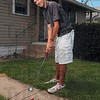 Tribune-Star/Joseph C. Garza<br /> Back to it one putt at a time: Terre Haute North senior-to-be Jacob Exline recently had heart surgery but is ready to return to the links.