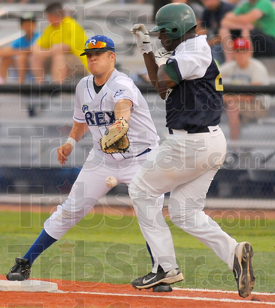 Safe at first: Rex firstbaseman Jase Morgan can't get a handle on the throw from his catcher Alex Deleon as Quincy batter Cecil Richardson reaches safely. Richardson struck out but Deleon dropped the ball making necessary the throw to first.