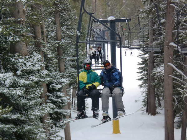 Aaron and Alicia riding Chair 3 to head back to the front-side at Kirkwood.  Photo by Harrison Turner.