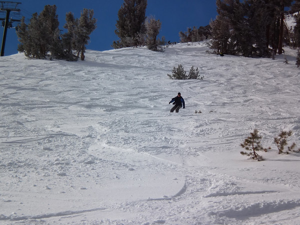 Alicia boarding down the powder on the backside @ Kirkwood.  Photo by Harrison Turner.