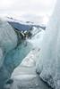 Icebergs frame the mountains around the Knik Glacier.