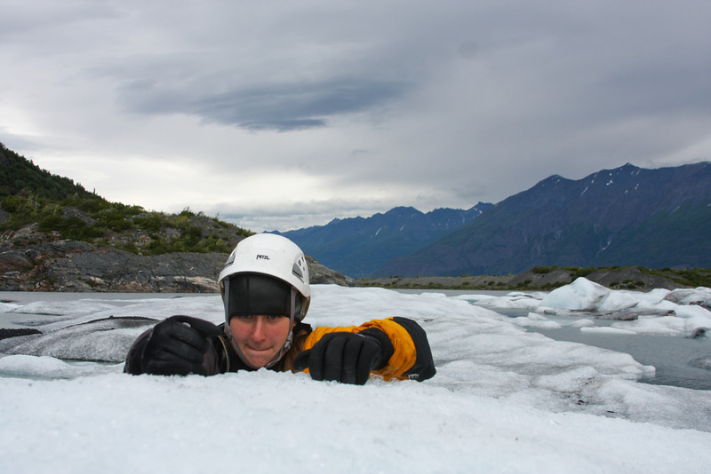Tracy Borland utilizes a water rescue knife for a purpose its designers may never have considered - climbing an iceberg.
