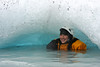 Tracy grins from a small concavity underneath an iceberg.