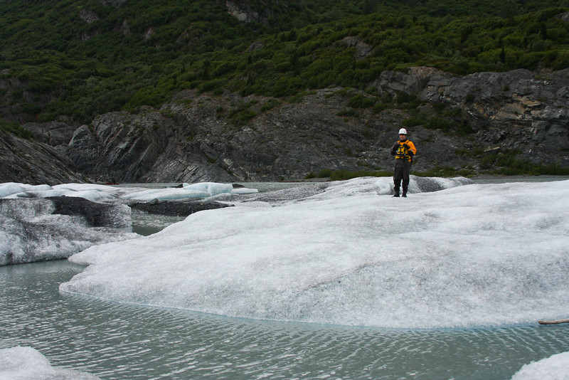 Casey Cook stands alone on a stranded iceberg at the foot of the Knik Glacier.