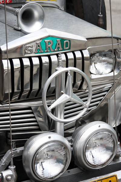 Local jeepneys are almost without exception decorated flamboyantly with as many eye-catching implements as possible.