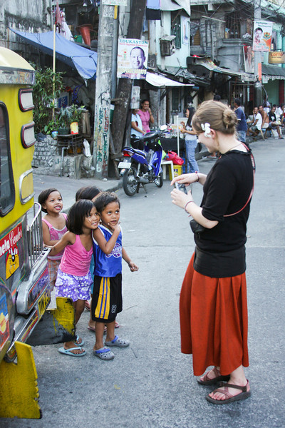 The children love to be photographed as we walk along the city streets.