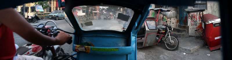 A panoramic view from inside a moving tricycle on the streets of Manila, Philippines.