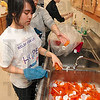 Tribune-Star/Joseph C. Garza<br /> Offering a helping hand: Creighton University junior Mary Doan, 21, of Wichita, Kan., washes dozens of pill bottles with fellow student, Trang Hoang, 21, of Omaha, Neb., Thursday at St. Ann Clinic. The two are spending their Spring Break volunteering in Terre Haute.