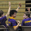 Looking good: Jared Wells, center, allows himself a slight grin as his Otter Creek Middle School team's victory becomes evident. With him are Tyler Knierin, left and Harry Chambers.