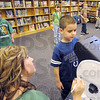 Test: Rebecca Waggoner explains the eye testing proceedure to third grader Brian Moats at Terre Town Elementary School Wednesday afternoon.