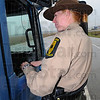 Just checking: Illinios State Police trooper Tammy Welborn chats with the passenger and driver in their semi tractor during a routine check Thursday afternoon.