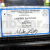 Licensed: The artist license  of Mike Fultz hangs in his work place at the Eternal Ink shop Thursday afternoon.