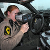 Laser tag: Illinios State Police trooper Tammy Welborn check the speed of traffic along the eastbound lanes of I-70 Thursday afternoon.