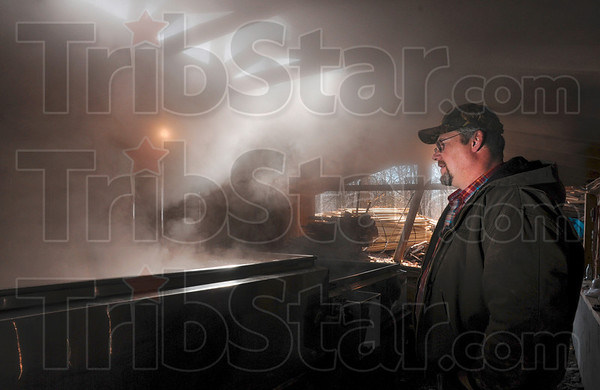 Tribune-Star/Joseph C. Garza<br /> Get your pancake mix ready: Maple syrup producer Kevin Smith begins the evaporation process at the Foxworthy Maple Syrup camp Thursday in Parke County. Smith's grandfather, Archie Foxworthy, began making the sweet pancake topping in 1954.