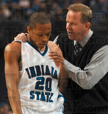 Tribune-Star/Joseph C. Garza<br /> Indiana State coach Kevin McKenna encourages Dwayne Lathan during the Sycamores' 65-60 win Friday over Colorado State at Hulman Center.