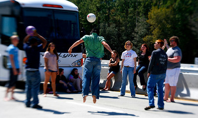 On the way back from tour in Florida the GWU Choir ran into sitting traffic on I-95 in Georgia for 3.5 hours.  In the essence of hospitality and to pass the time the students serenaded the other unfortunate drivers and even some elementary school kids.  The students made the best of things by playing a little ball.