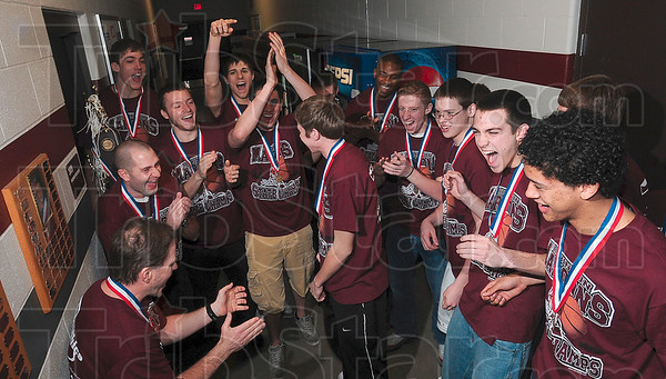 Tribune-Star/Joseph C. Garza<br /> A brief victory dance: The teammates of Derek Hannahs laugh after he completed a brief dance before the team took the floor of the Robinson High School gymnasium to celebrate the Maroons' state championship victory Sunday at the school.