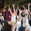 "Tribune-Star/Joseph C. Garza<br /> What a ride!: Robinson High School students demonstrate the ""roller coaster"" during the ceremony celebrating the Maroons' victory in the state championship at the school Sunday."