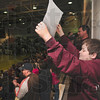 "Tribune-Star/Joseph C. Garza<br /> Welcome back, state champs!: Jacob Ludwig, 13, holds up a sign with the words, ""State Champs,"" printed on it during the ceremony to celebrate the Maroons' state championship victory Sunday at the school."