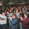 Tribune-Star/Joseph C. Garza<br /> Proud of their Maroons: Robinson fans stand and applaud the team in the school's gymnasium during a ceremony to celebrate the team's state championship.