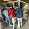 Storage: A group of students construct shelving for supplies for Deborah's House Saturday afternoon.
