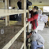 Storage: A group of students construct shelving for supplies at Deborah's House in Terre Haute on Saturday afternoon.