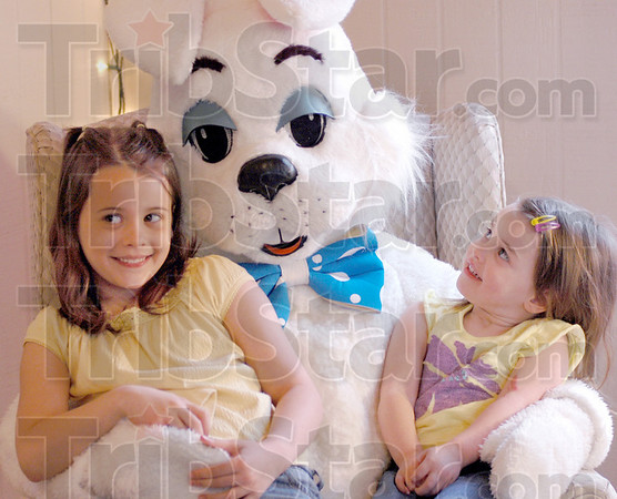 Bunny pic: Eight-year-old Sierra Worthen and two-year-old Addison Keil of Terre Haute are happy about having their picture taken with the Easter Bunny Sunday afternoon at Deming Park.