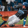 Tribune-Star/Joseph C. Garza<br /> Race to the plate: Indiana State's Jordan Pearson begins his slide past Tennessee-Martin catcher Ty Nelson as the throw to home plate comes in Sunday at Bob Warn Field. Pearson beat the tag and scored a run for the Sycamores during their home game against the Skyhawks.