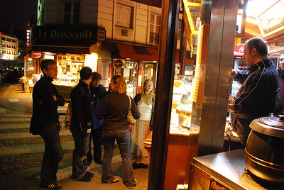 Dr. Jones and students order crepes to eat while watching the city of Paris light up at SacrŽ-Coeur.